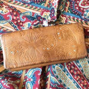 Fossil Embossed Leather Bi-Fold Clutch Wallet
